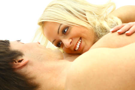 foreplay sex:  Lovely young couple having fun in the bedroom  Stock Photo