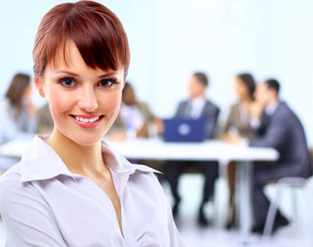 Portrait of a cute young business lady looking happy at office Stock Photo - 11480712