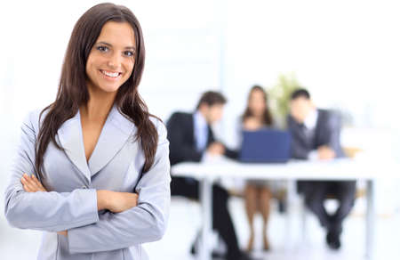 team success: Portrait of successful businesswoman and business team at office meeting