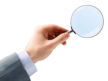 Magnifying glass in hand isolated over white background photo