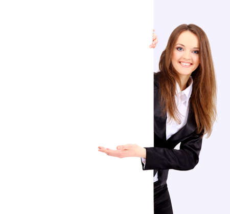 displaying: Businesswoman standing and holding a white empty billboard Stock Photo
