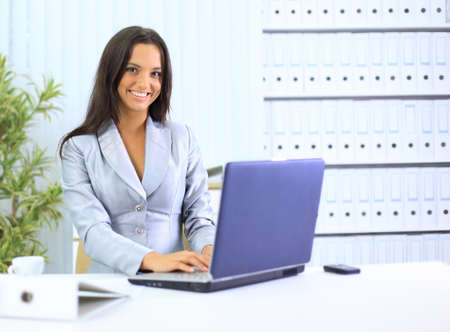 businesswoman working with laptop at office photo