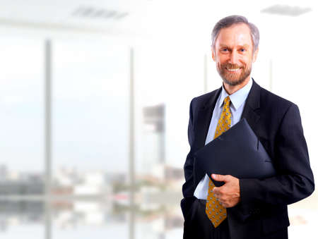 mid life: Portrait of a happy successful mature business man  Stock Photo