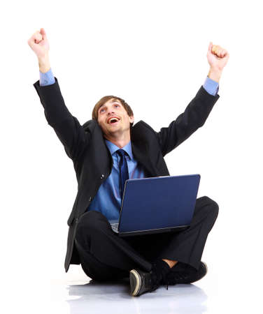Happy young business man working on a laptop, isolated against white background Stock Photo - 11481430