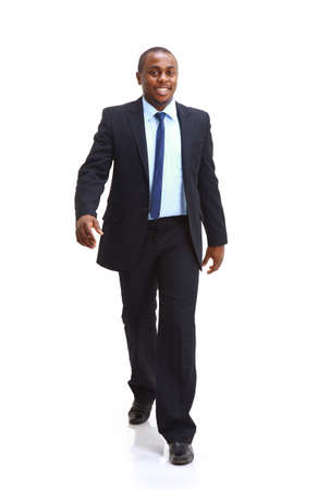 Full length of a confident young African American business man standing on white  photo