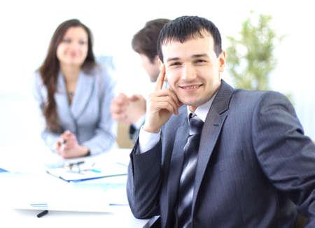 environmen: Portrait of a ambitious business man in an office environmen