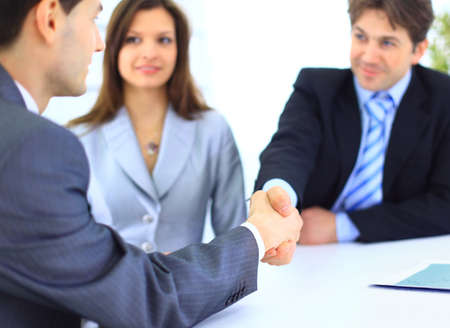 Business people shaking hands, finishing up a meeting Stock Photo - 11481531