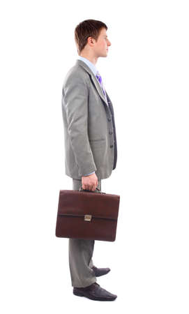 Full length profile of a middle aged business man with coat over shoulder against white photo