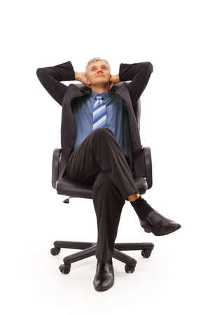 Relaxed middle aged business man seated on a chair isolated on white  photo