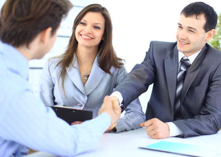 unanimous: Business people shaking hands, finishing up a meeting
