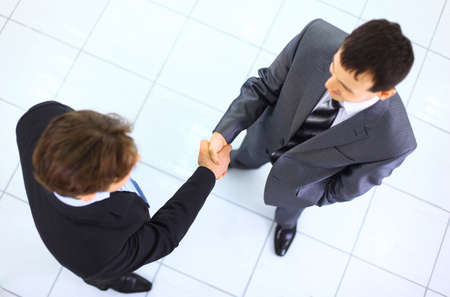 Business handshake and trust taken from above photo