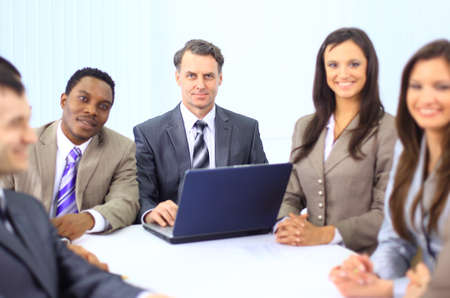 Multi ethnic business executives at a meeting discussing a work  Stock Photo - 11618185