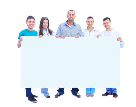 Happy young group of people standing together and holding a blank sign for your text  photo