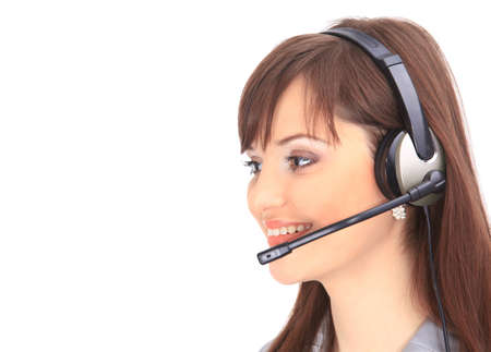 Woman wearing headset in office; could be receptionist  Stock Photo - 11628141