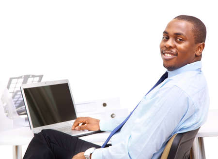 Portrait of a handsome young business man with a laptop  Stock Photo - 11639467