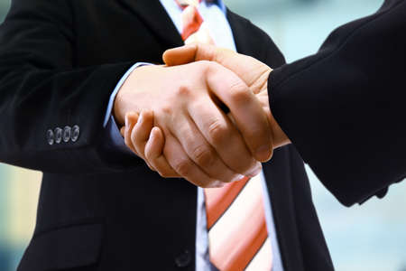 client meeting: handshake isolated on light background