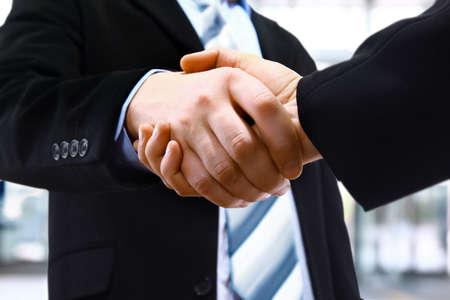 trustworthy: handshake in office