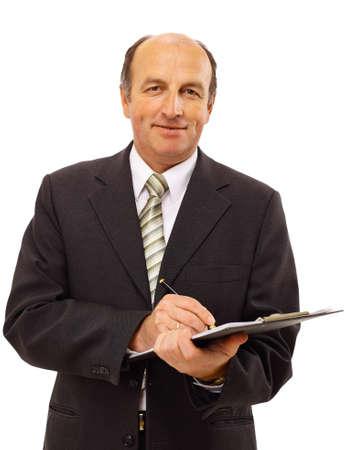 taking notes: Businessman writing isolated over white background