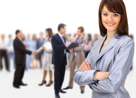 small group: Happy young business woman standing in front of her team  Stock Photo