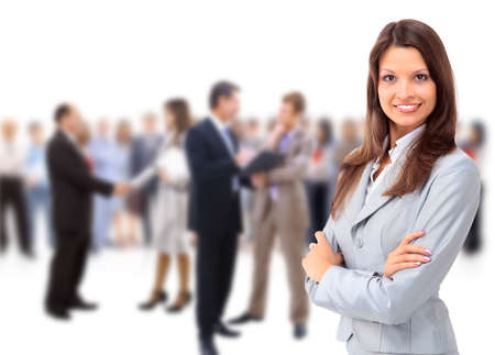 business woman standing: Happy young business woman standing in front of her team  Stock Photo