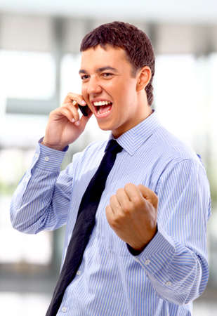 Young businessman using mobile phone  photo