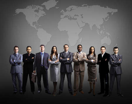 corporation: Businessmen standing in front of an earth map  Stock Photo