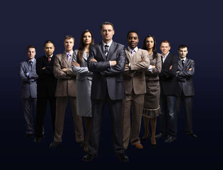 black business men: business team formed of young businessmen standing over a dark background