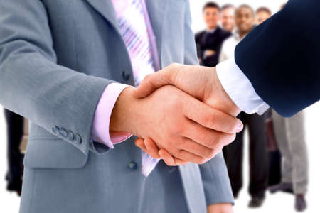 business  deal: handshake isolated on business background