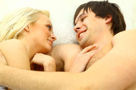 Lovely young couple having fun in the bedroom  Stock Photo - 11669471