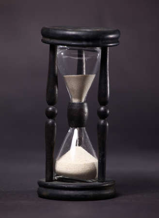 watch over: Sand-glass with flowing sand took close
