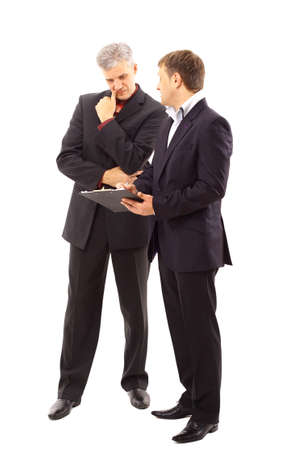 two people talking: Two businessmen discussing - Isolated studio picture in high resolution.  Stock Photo