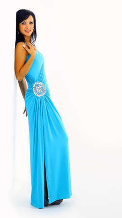 young girls breast: Young sexy woman in stylish blue dress isolated
