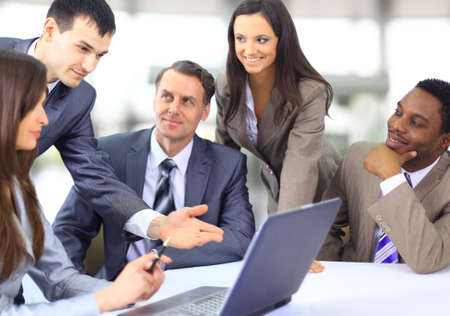 Multi ethnic business executives at a meeting discussing a work  photo