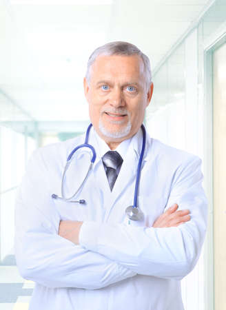 man doctor: Closeup portrait of a happy senior doctor with stethoscope  Stock Photo