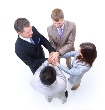 Group of business colleagues with their hands together photo