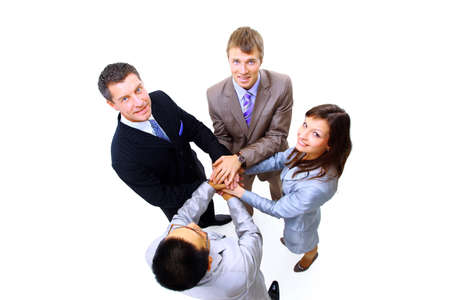 multi ethnic: Top view of business people with their hands together in a circle