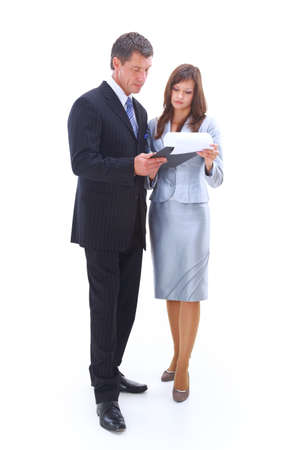Portrait of a cheerful business couple standing together with folded arms on white background  photo