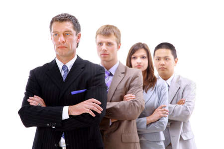 serious businessman: businessman leading a business team in a line  Stock Photo