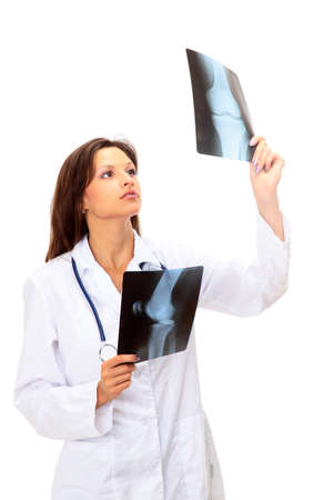 x ray equipment: young and nice doctor watching a patient x-ray in hospital  Stock Photo
