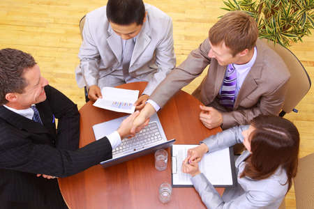 technology deal: Portrait of businesspeople having a business meeting  Stock Photo