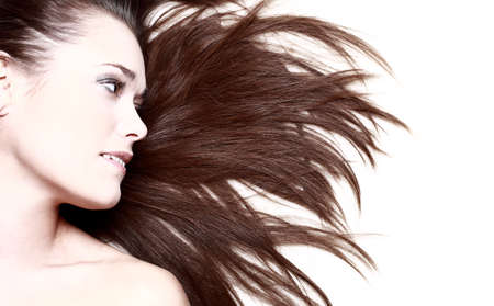 flowing hair: woman with her hair blowing and smiling