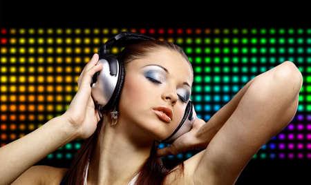 Portrait of a young dancing girl in headphones  Stock Photo