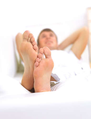 Modern lifestyle - macro of mans feet, man resting photo