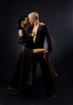 latin dancing: dancers against black background Stock Photo