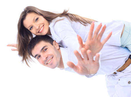 happy couple white background: Smiling young man carrying his beautiful girlfriend on his back with their hands outstretched  Stock Photo