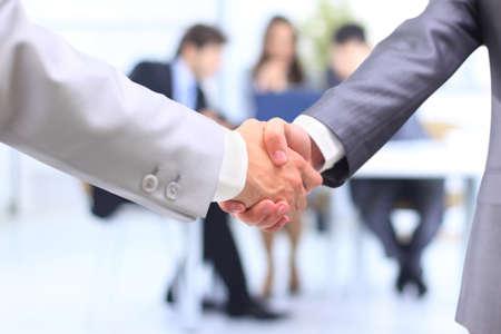 promising: handshake isolated on business background