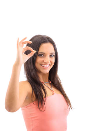 Portrait of a cute female showing an OK sign isolated over white background  photo