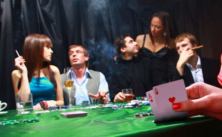 women smoking: group of sinister poker players Stock Photo