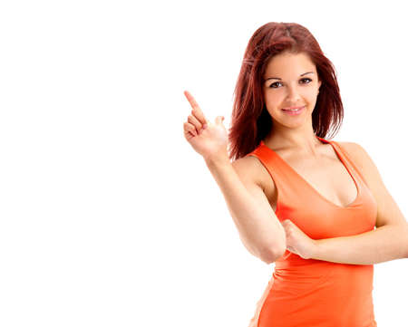 woman pointing up: Young beautiful female executive pointing at copyspace