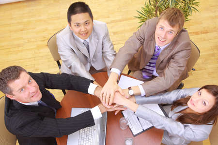 businessteam: businessteam and hands on top of each other
